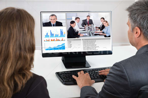 Two Businesspeople Participating In Video Conference Stock photo © AndreyPopov
