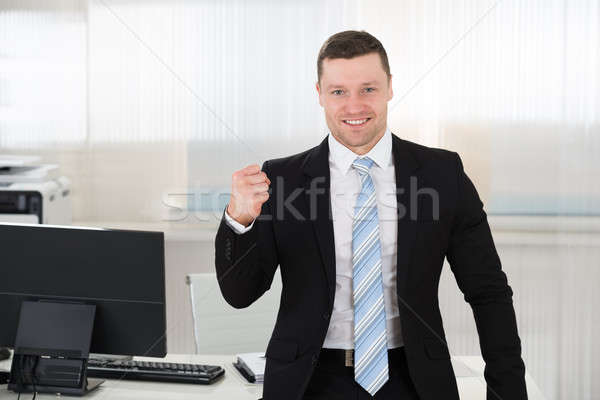 Successful Businessman Clenching Fist In Office Stock photo © AndreyPopov