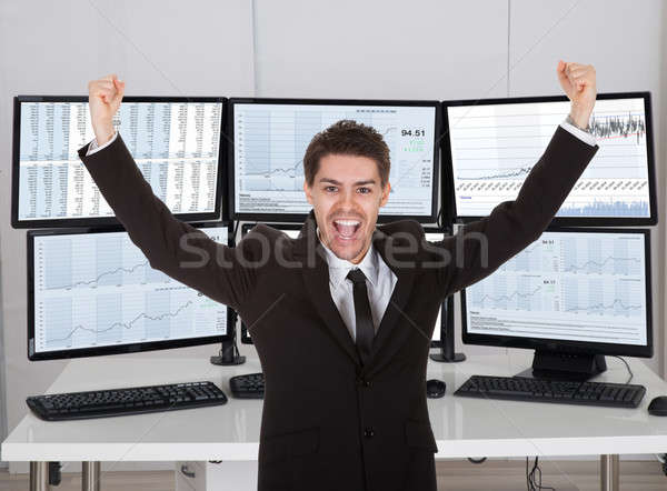 Broker Laughing While Standing With Arms Outstretched Stock photo © AndreyPopov