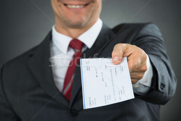 Close-up Of Businessman Hands Giving Cheque Stock photo © AndreyPopov