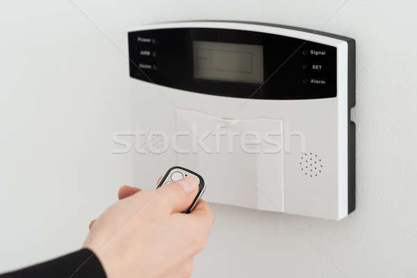 Woman Hand Using Remote To Operate Entrance Security System Stock photo © AndreyPopov