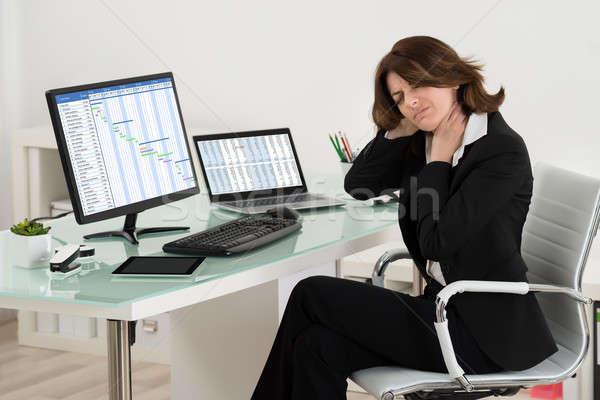 Empresária sofrimento trabalhando escritório negócio Foto stock © AndreyPopov