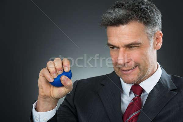Businessman Pressing Stressball In Hand Stock photo © AndreyPopov