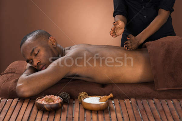 Man Getting Massage In Spa Stock photo © AndreyPopov