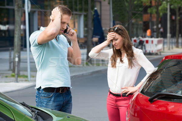 Man On Mobile Phone After Car Collision Stock photo © AndreyPopov