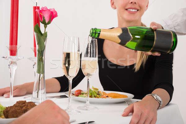 Femenino camarera champán vidrio Pareja Foto stock © AndreyPopov