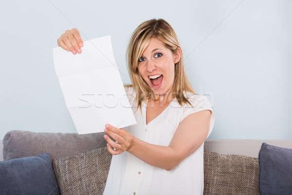 Happy Woman Reading Letter Stock photo © AndreyPopov