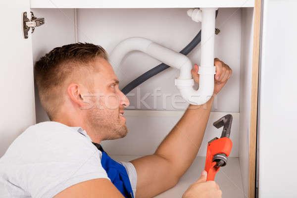 Male Plumber Repairing Sink Pipe Stock photo © AndreyPopov
