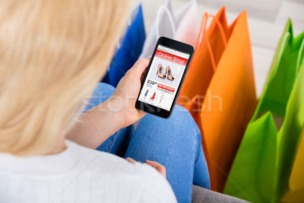 Woman Holding Mobilephone Shopping Online Stock photo © AndreyPopov