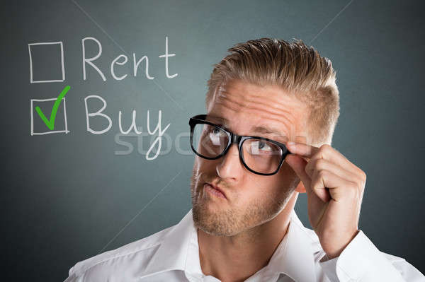 Business Man Choosing Rent Or Buy Option Stock photo © AndreyPopov