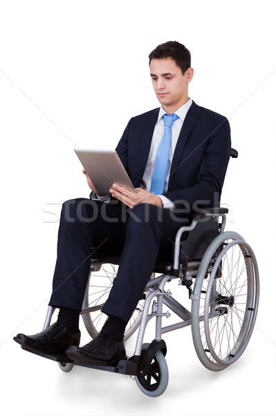 Handicapped Businessman Using Digital Tablet Stock photo © AndreyPopov