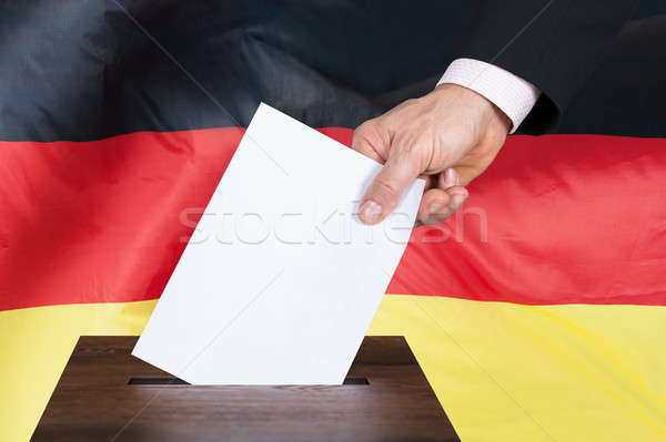 Person Putting Vote In A Ballot Box Stock photo © AndreyPopov