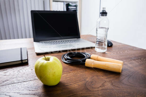 Workout Equipment On Wooden Desk Stock photo © AndreyPopov