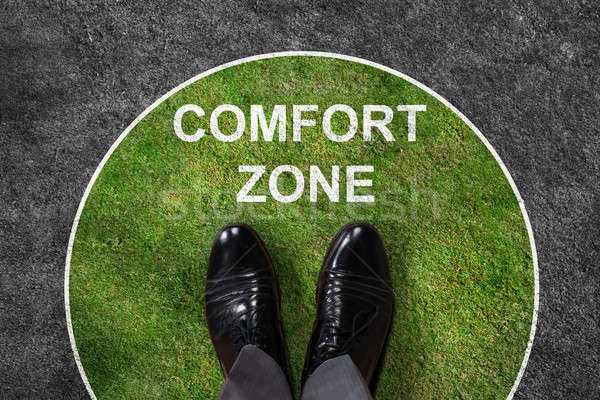 Businessman Standing In Comfort Zone Text Stock photo © AndreyPopov