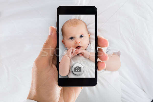 Stock photo: Person Taking Picture Of A Baby