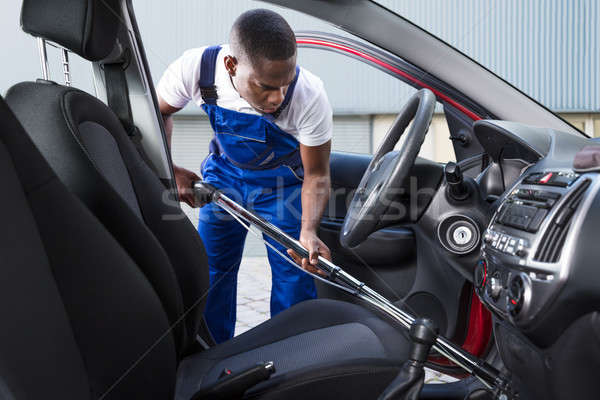Worker Vacuuming Car Interior Stock photo © AndreyPopov