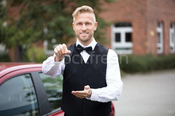 Male Valet Holding Car Keys Stock photo © AndreyPopov