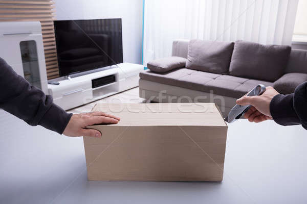 Person's Hand Opening Cardboard Box Stock photo © AndreyPopov