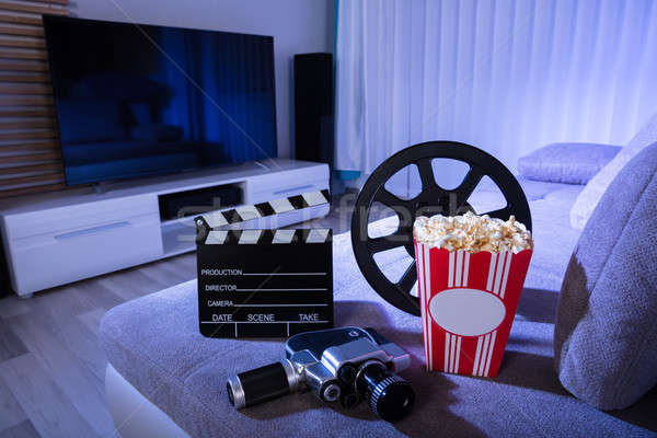 Movie Camera With Clapperboard And Popcorn Stock photo © AndreyPopov