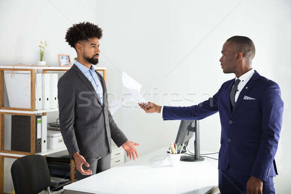 Dissatisfied Boss Giving Document To Employee Stock photo © AndreyPopov