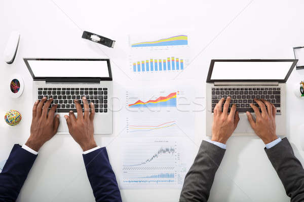 High Angle View Of Two Businesspeople Using Laptop Stock photo © AndreyPopov