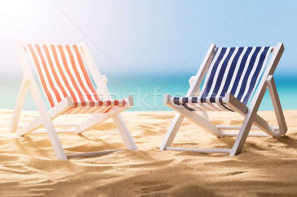 Dwa pokład krzesła niebieski czerwony Zdjęcia stock © AndreyPopov