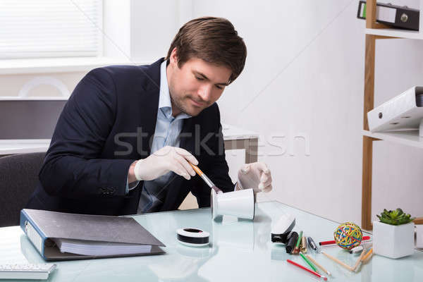Investigator Looking For Finger Print On Pencil Holder Stock photo © AndreyPopov