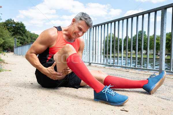 Man With Sprain Thigh Muscle Stock photo © AndreyPopov