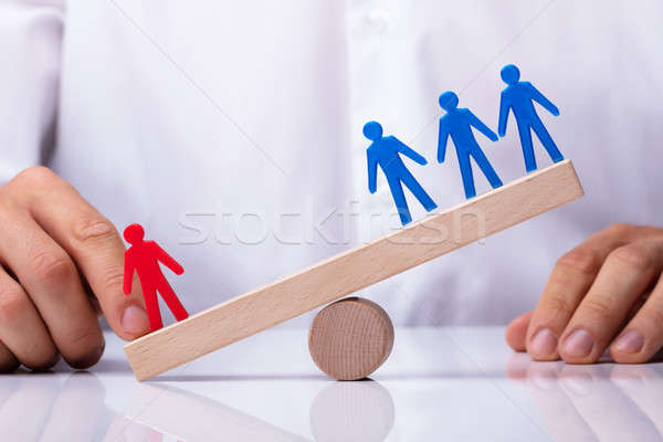 Businessperson Showing Red Figure Competing Against Blue Team Stock photo © AndreyPopov