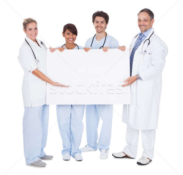 Group of doctors presenting empty board Stock photo © AndreyPopov