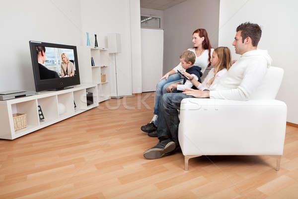 Fiatal család néz tv otthon együtt Stock fotó © AndreyPopov