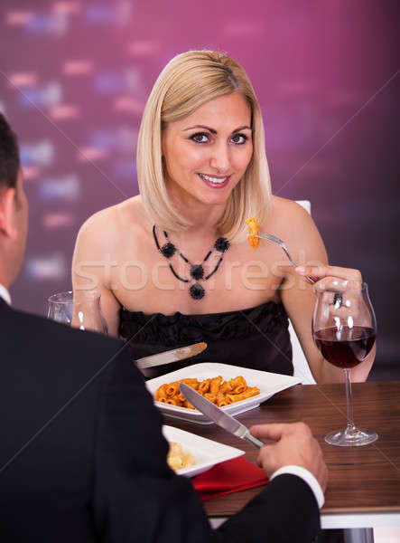 Couple Having Dinner At Restaurant Stock photo © AndreyPopov