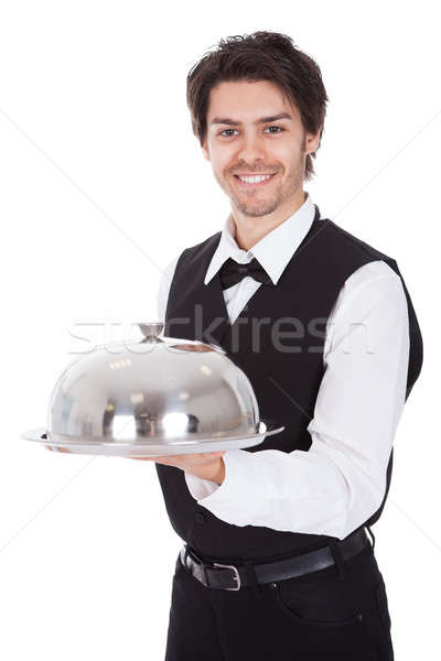 Portrait of a butler with bow tie and tray Stock photo © AndreyPopov
