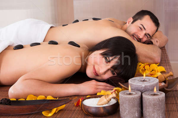 Beautiful Young Couple Enjoying Hot Stone Therapy Stock photo © AndreyPopov