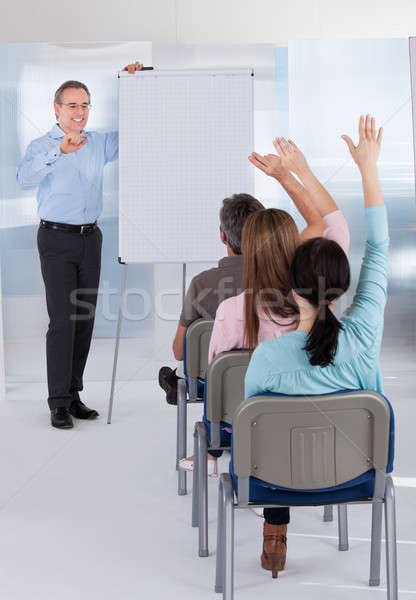 Mature Teacher Teaching Students Stock photo © AndreyPopov