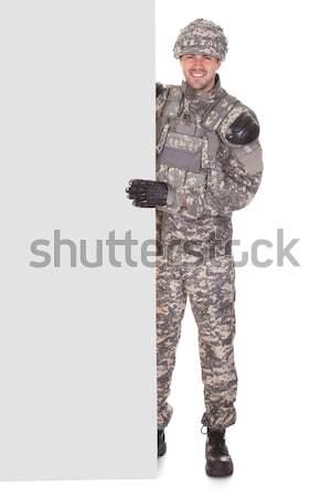Portret geweer ernstig geïsoleerd witte Stockfoto © AndreyPopov