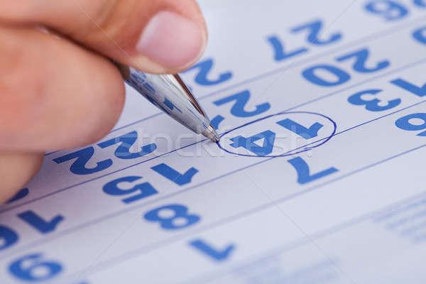 Close-up Of Man Marking On Calendar Stock photo © AndreyPopov