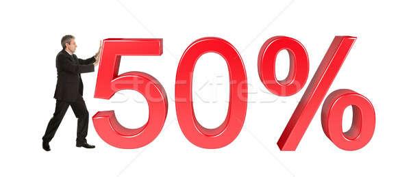 Businessman pushing 50% sale sign Stock photo © AndreyPopov