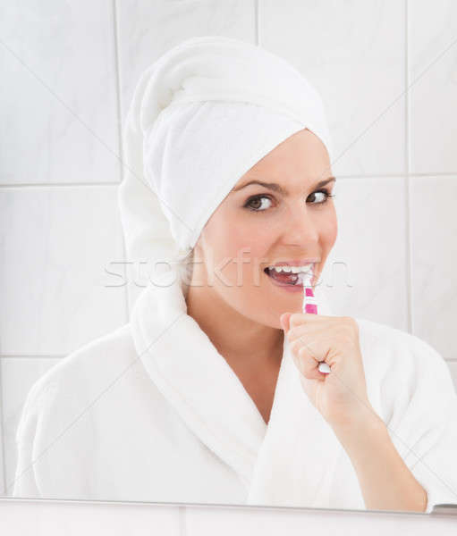 Young woman brushing teeth Stock photo © AndreyPopov