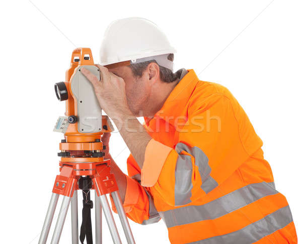 Stock photo: Senior land surveyor with theodolite