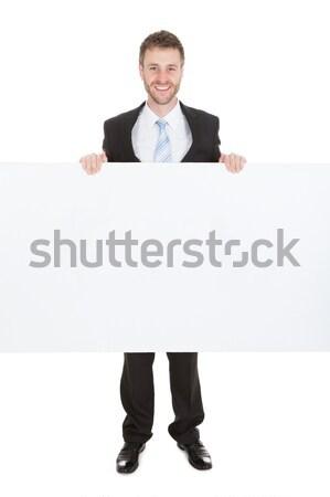 üzletasszony tart plakát boldog fehér háttér Stock fotó © AndreyPopov