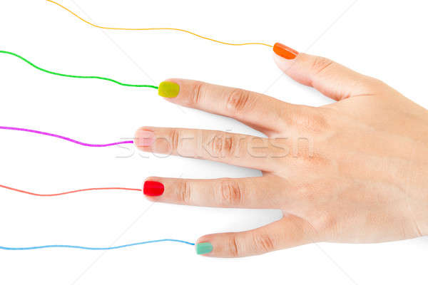Woman's Hand With Multi Colored Nail Paint Stock photo © AndreyPopov