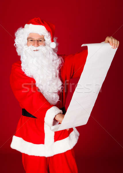 Portrait of a santa holding paper scroll Stock photo © AndreyPopov
