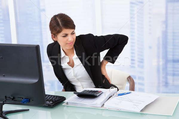 Zmęczony kobieta interesu cierpienie ból w krzyżu młodych posiedzenia Zdjęcia stock © AndreyPopov