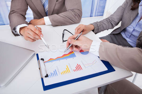 Business People Discussing Over Graph In Office Stock photo © AndreyPopov