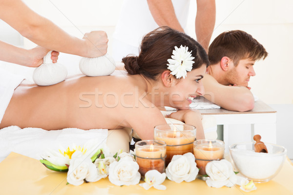 Woman Receiving Massage With Herbal Compress Stamps Stock photo © AndreyPopov