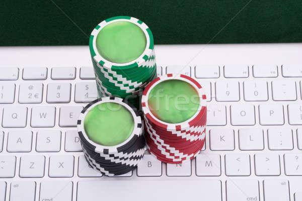 Línea juego fichas de casino ordenador teclado Foto stock © AndreyPopov