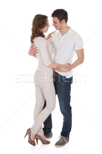 Couple In Casuals Embracing Over White Background Stock photo © AndreyPopov
