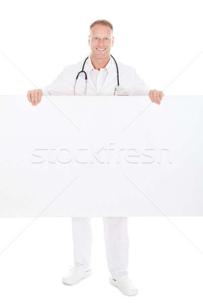 Happy Male Doctor Displaying Billboard Stock photo © AndreyPopov