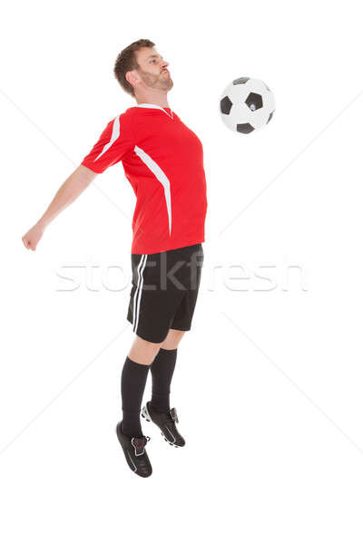 Player Hitting Soccer Ball With Chest Stock photo © AndreyPopov